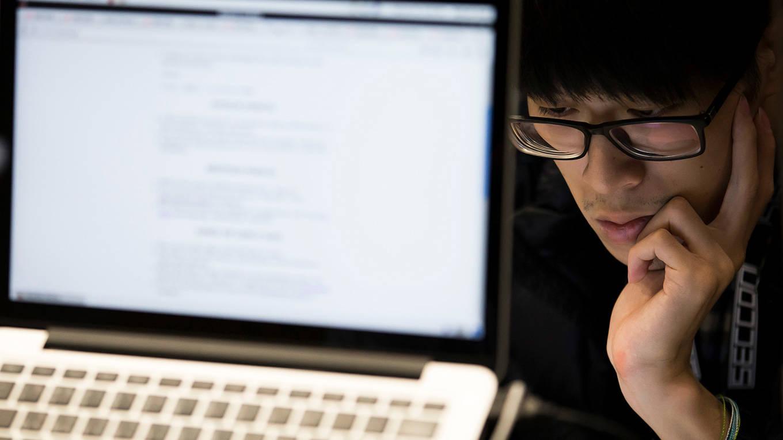 A participant uses a laptop computer