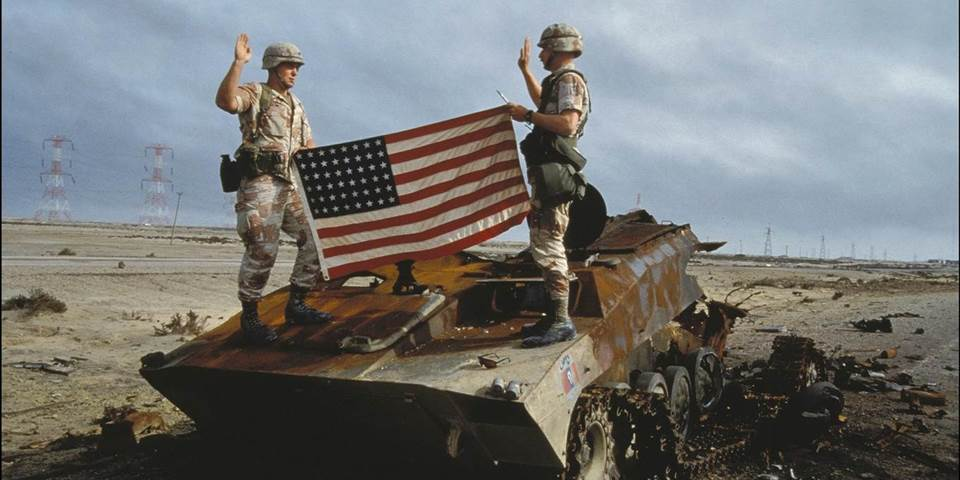 US soldiers take oath to the US army on an Iraqi destroyed tank in Iraq
