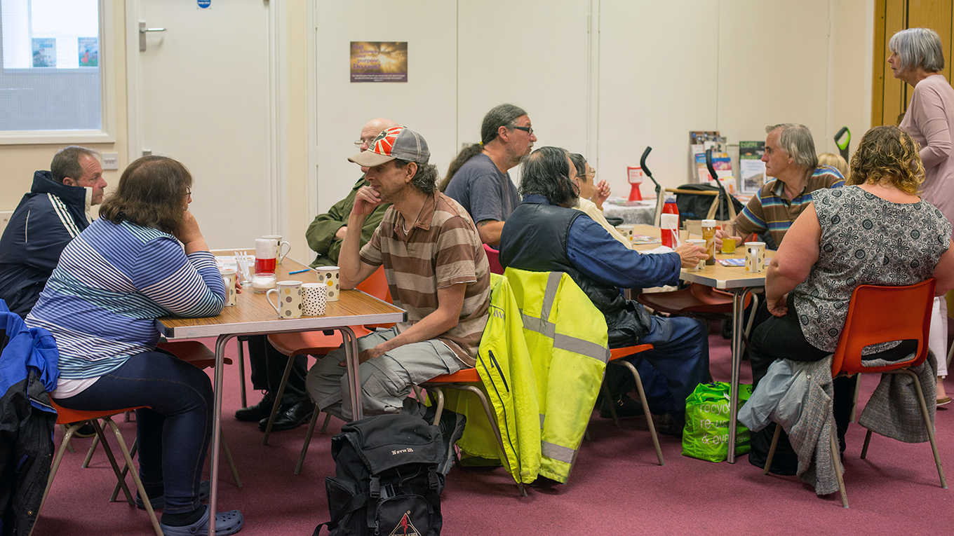 Visitors and volunteer at the Salvation Army