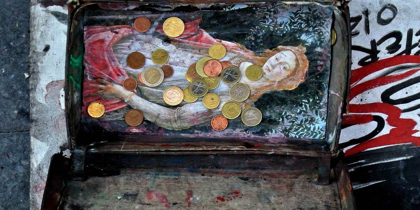 Picture of Euro coins in the box of a street performer