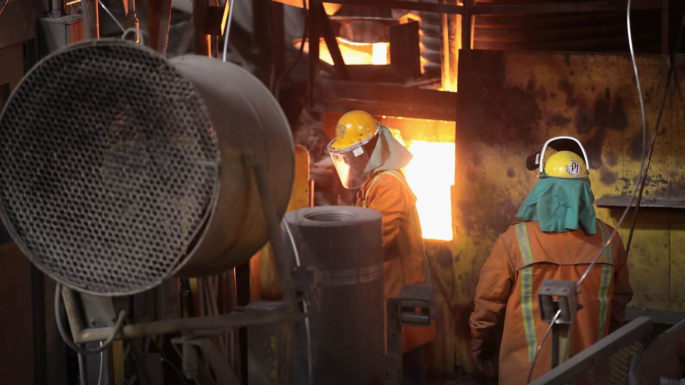 Workers make steel at the NLMK Indiana mill