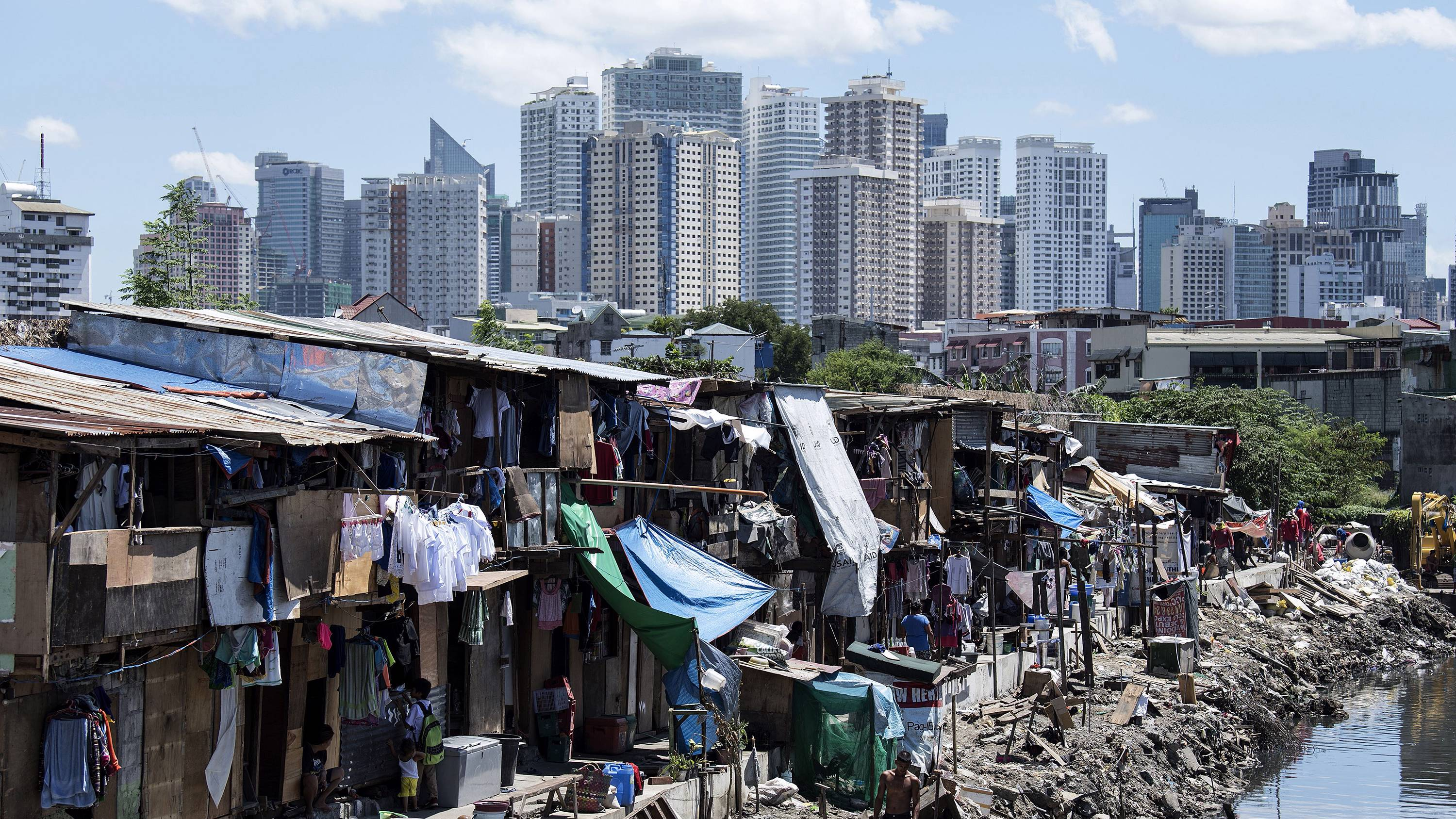 sumner1_NOEL CELISAFP via Getty Images_povertyrichslumcity