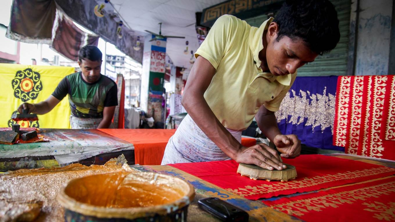 Local workers making clothes from hand painted cloth