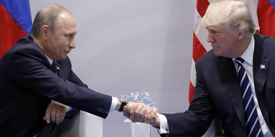 Russia's President Vladimir Putin and US President Donald Trump shake hands