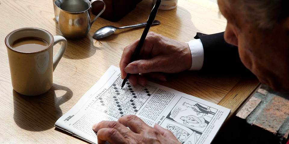 A man does the crossword