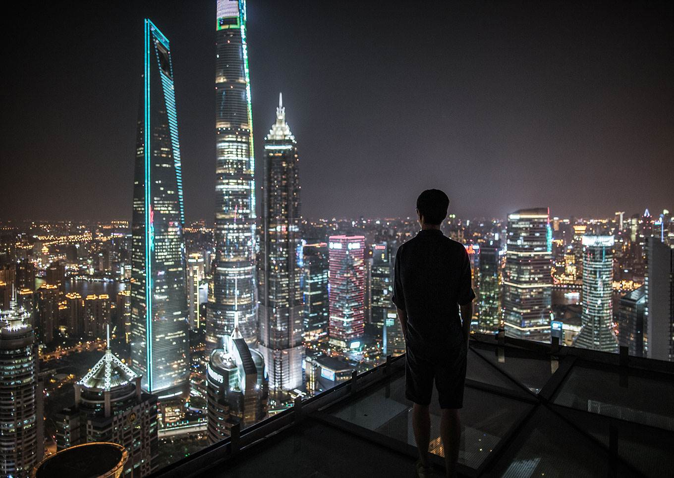 man looking at skyline chinese city