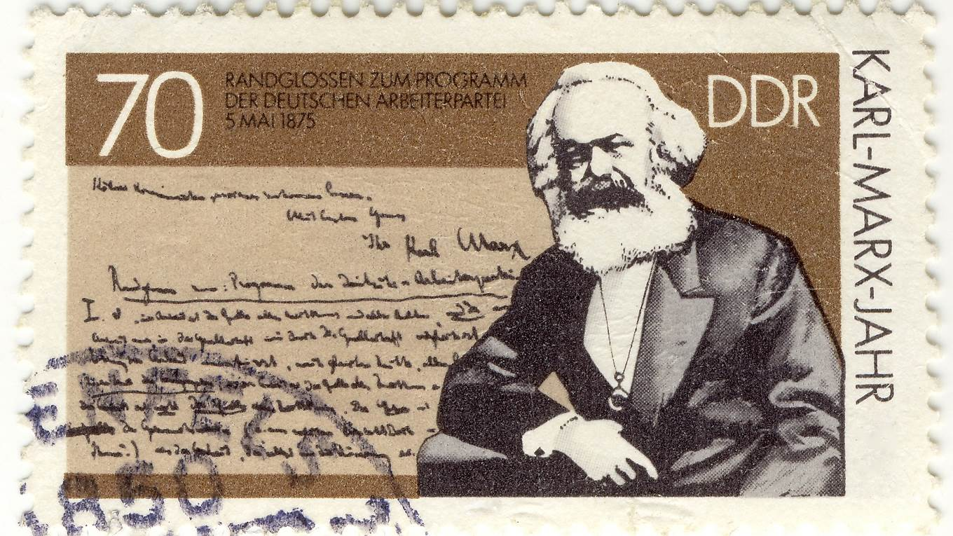 Vintage stamp with German creator of communism Karl Marx