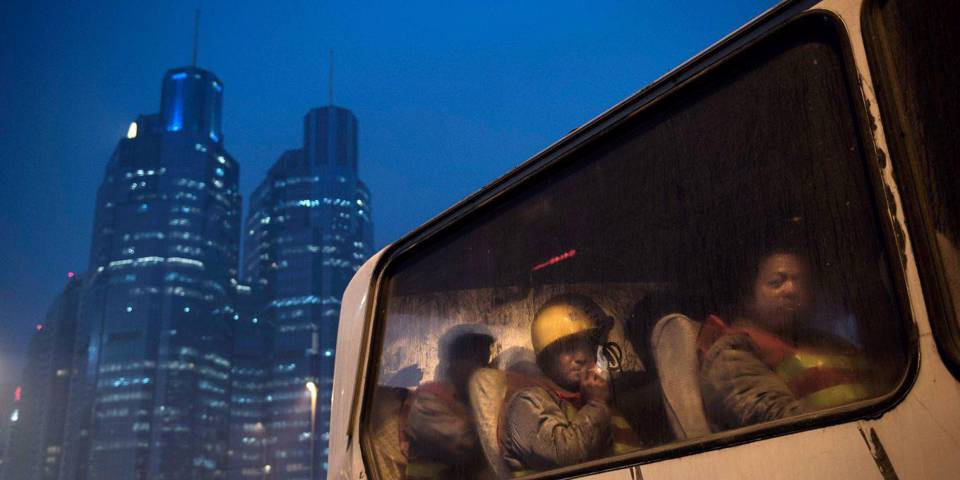 sheng96_ Kevin FrayerGetty Images_china workers bus