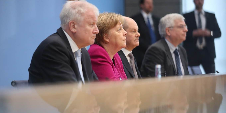 Angela Merkel, Acting Chairman of SPD Olaf Scholz and Chairman of CSU Horst Seehofer