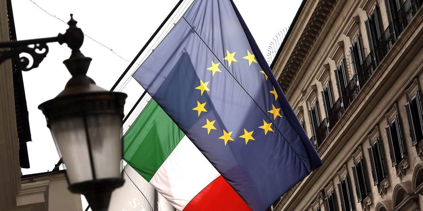 European Union (EU) and Italian national flag banners hang in central Rome