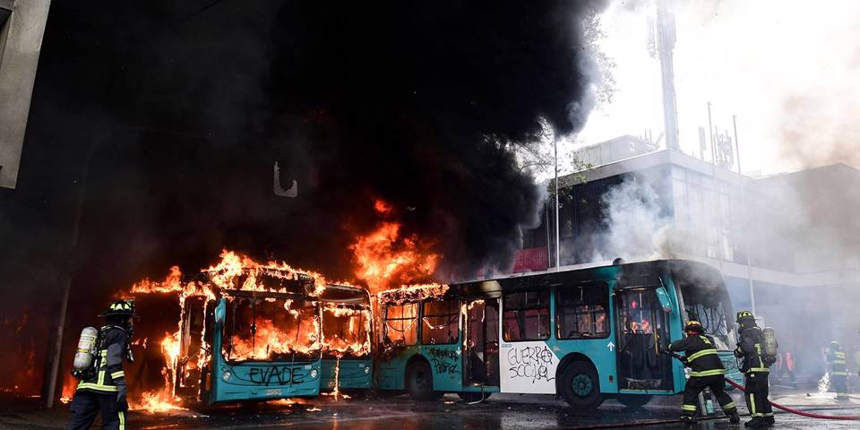 adelman3_MARTIN BERNETTIAFP via Getty Images_chileprotestburningbus