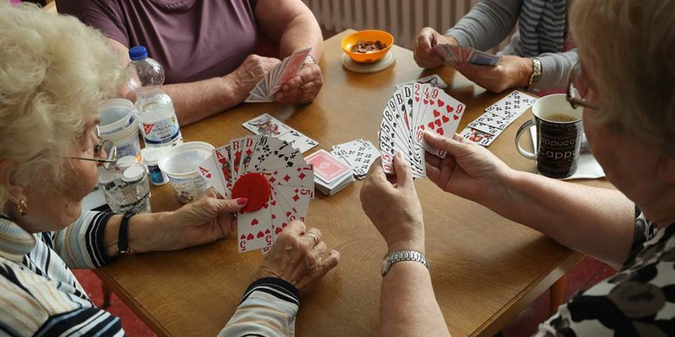 retirees play cards