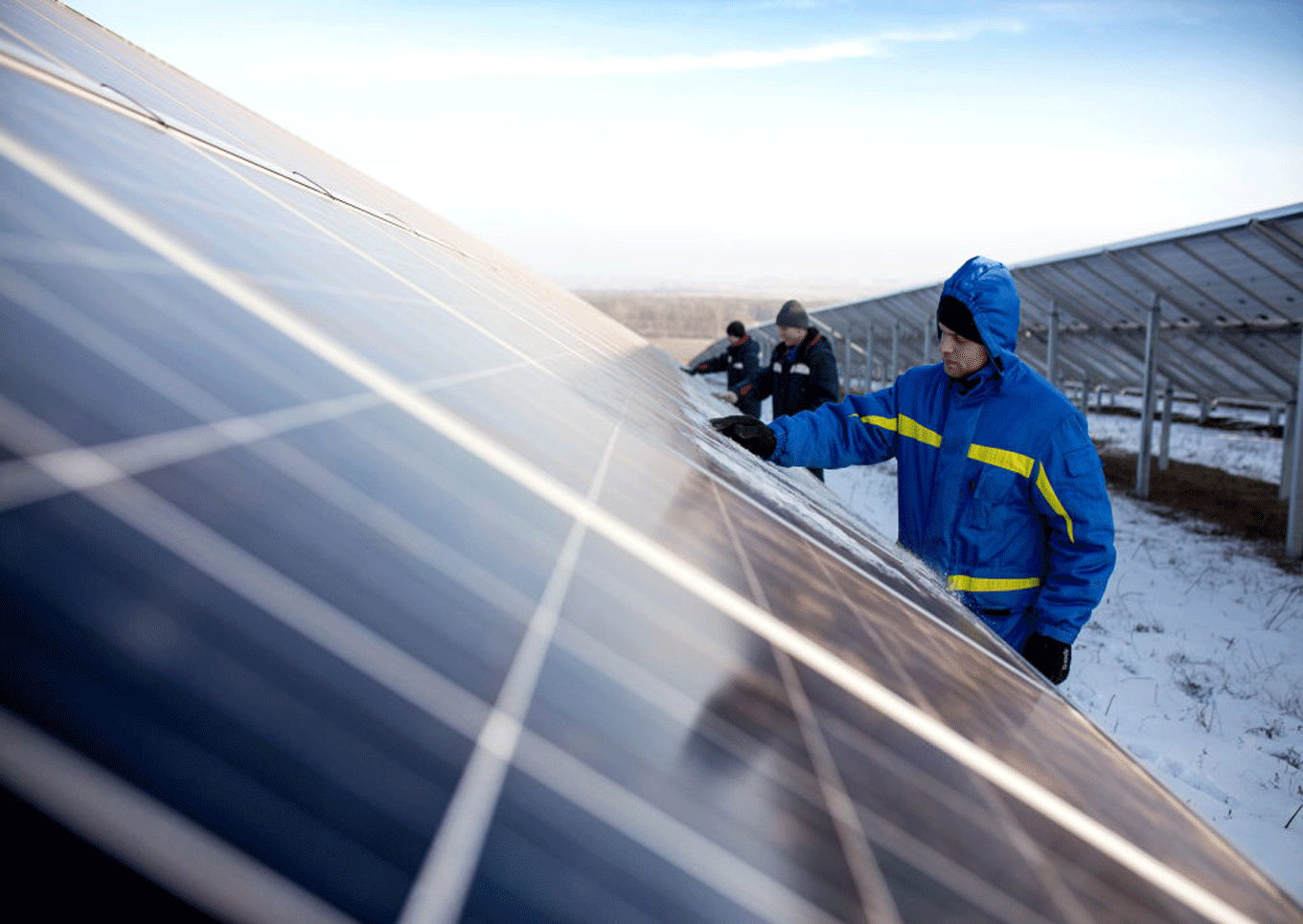 workers solar panels