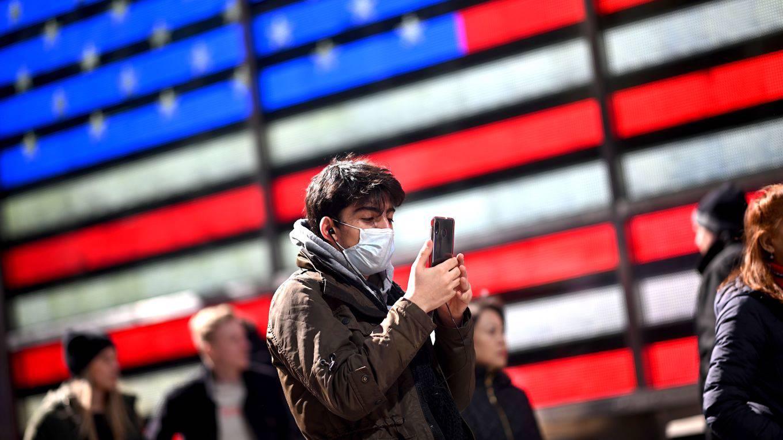 qian1_JOHANNES EISELEAFP via Getty Images_covid mask USA