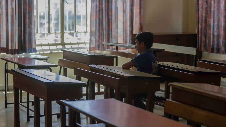 watkins20_ JOSEPH EIDAFP via Getty Images_child in school