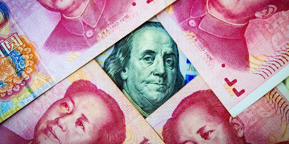 gros125_GettyImages_yuanoverlayingdollar