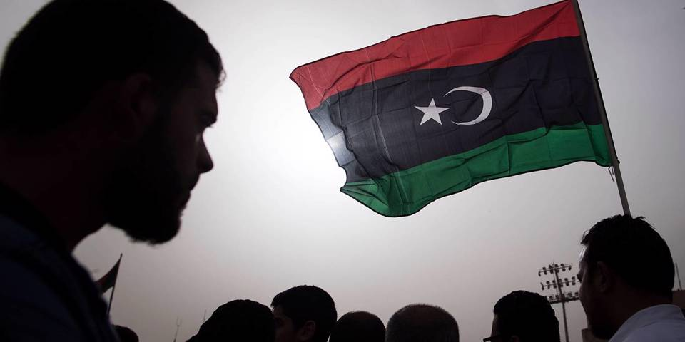 solana114_FADEL SENNAAFP via Getty Images_libyaprotestflag