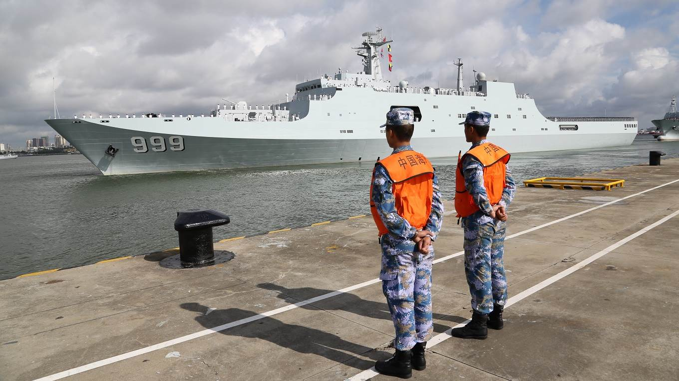 Ships carrying Chinese military personnel depart at a port