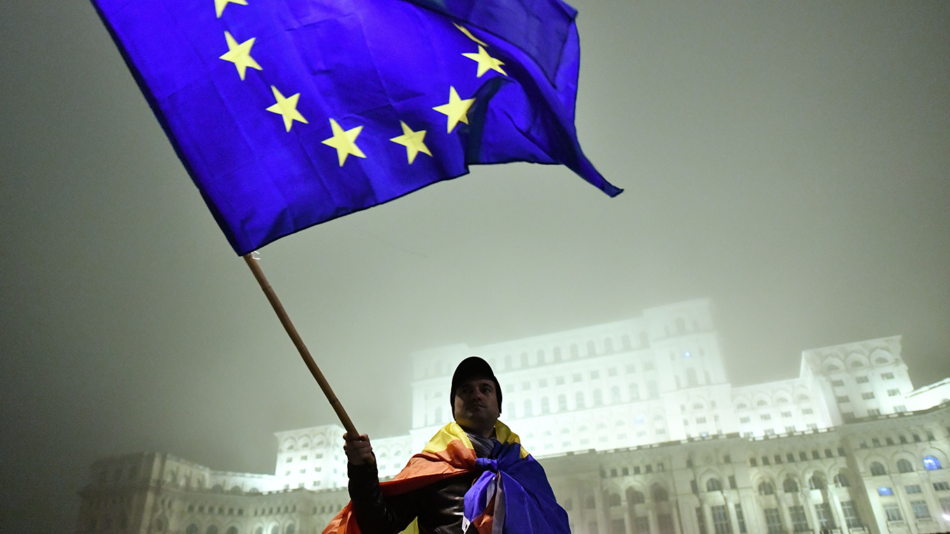 A man waves a European Union flag