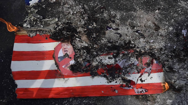 op_krastev1_TED ALJIBEAFP via Getty Images_USflagburntrump