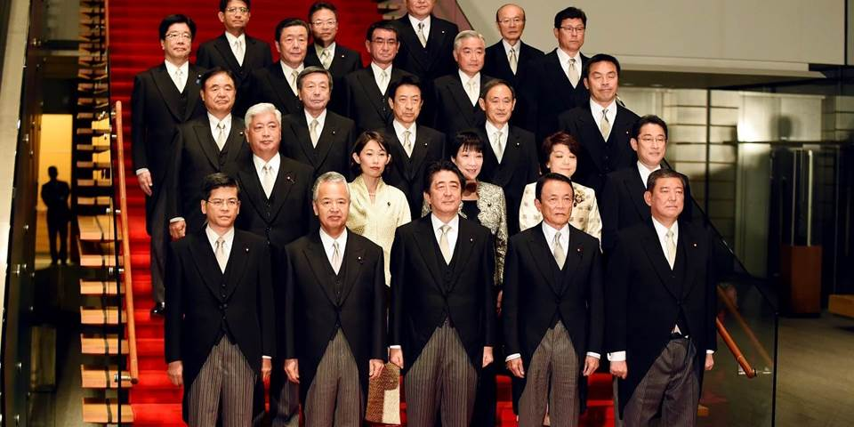 Japanese Prime Minister Shinzo Abe poses with members of his cabinet